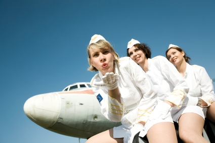 Airline stewardesses blowing kisses